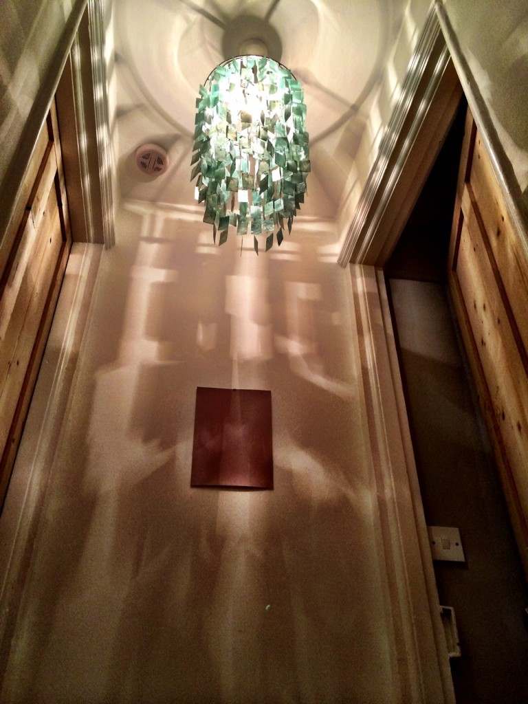 pendant light shade at the top of the stairs