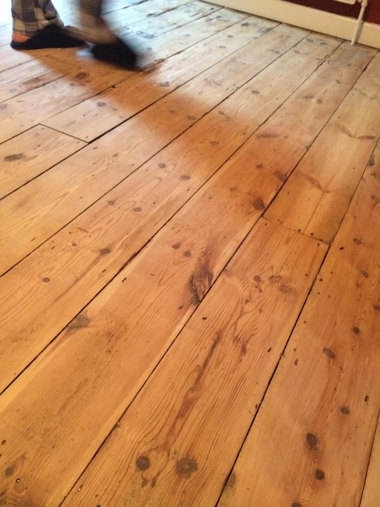 sanded floorboards (and booyaa's feet)