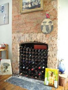 or lovely bare brick chimney and look at all that vino!