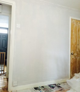 Same wall, with one coat of paint on (Betsy's jail through the door on the left)