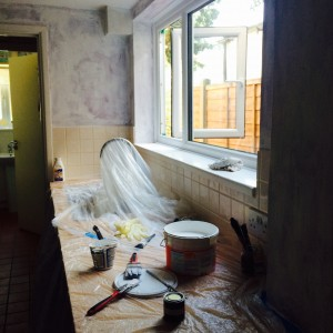 Covered up kitchen, featuring blotchy basecoat in the background there